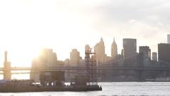 An establishing shot of New York City's skyline at sunset - summer - 2016 Stock Footage