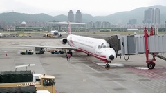 Airplane on the runway of Taipei Songshan Airport in Taiwan. Stock Footage