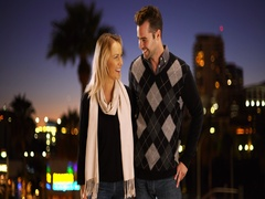Caucasian man proposes to his girlfriend at night outdoors Stock Footage
