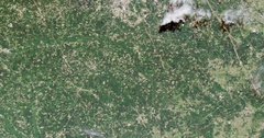 High-altitude overflight aerial of tornado tracks across metro Tuscaloosa, AL Stock Footage