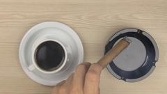 Smoking a cigar and drinking a cup of hot coffee. Stock Footage