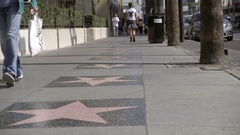 Hollywood Boulevard stars on street from low angle in slow motion in Los Angeles Stock Footage