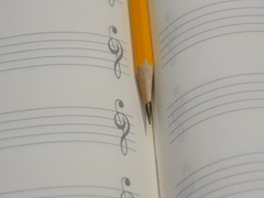 Pencil on music note book in rotation Stock Footage