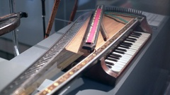 Old vintage unique small piano with strings, medium shot, shallow DOF Arkistovideo
