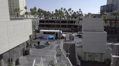 Palm trees over parking garage on Hollywood Boulevard in Los Angeles Stock Footage