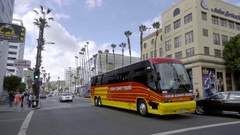 Gold Coast Tours tourism bus driving down Hollywood Boulevard in Los Angeles Stock Footage