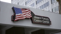 Armed Forces Career Center sign with American flag on building in Hollywood LA Stock Footage