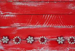 Garland with felt snowflakes on red shabby wooden surface Stock Photos