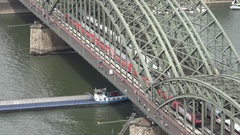 4K Aerial view of traffic train on Hohenzollern bridge in Koln barge ship sail Stock Footage