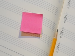 Pencil on music note book with post it paper Stock Footage