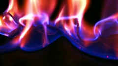 Blue and red flame background in dark. Burning liquid looks like a plasma. Stock Footage
