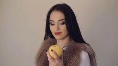 Smart girl flirting with apple to the camera 4K Stock Footage