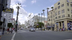 Panning across Hollywood Boulevard with LA Fitness and cars driving in LA Stock Footage