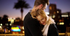 Sweet modern couple hugging outdoors at night Stock Footage