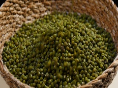 Pouring a mass of mung beans on wicker basket Stock Footage