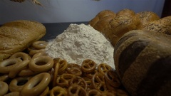 Flour, bread and ears of wheat close HD Stock Footage