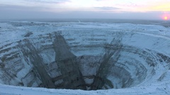 Aerial shot of big abandoned open mining pit kimberlite pipe Stock Footage