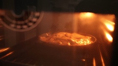 Apple pie in the oven. Stock Footage