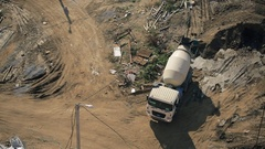 Mixer truck transport cement to casting place on building site Stock Footage