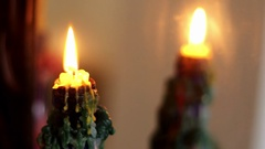 Mirror reflection of burning candle Stock Footage