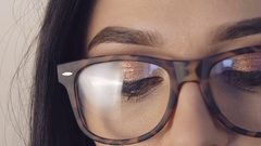 Close up of girl undressing glasses and loking to camera Stock Footage