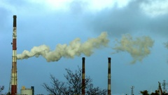 Reek, smoke, fumes from industrial chimney Stock Footage