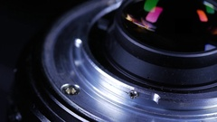 Macro close up of camera lens mount rotating around Stock Footage
