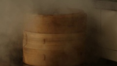 Bamboo steamer with dumplings inside to cook them. Stock Footage