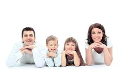 Beautiful happy family - isolated over a white background Stock Photos