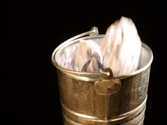 Put Crumpled papers in turning metal basket Stock Footage