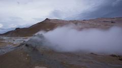 Mudpot hot spring Iceland nature landscape volcano destination: Namafjall hverir Stock Footage