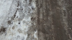 Treads and footprints in snow, city street covered in snow. Stock Footage