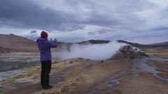 Iceland volcano mudpot hot spring landmark destination: Namafjall hverir Stock Footage