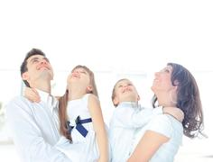 Harmonious family laying down and looking up Stock Photos