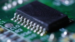 Macro close up of electronic chip with circuits rotating around 5 Stock Footage