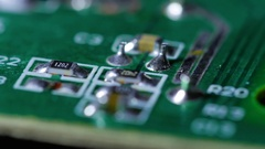 Macro close up of electronic chip with circuits rotating around 4 Stock Footage