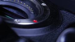 Macro close up of dslr camera body and mirrorless sensor rotating around Stock Footage