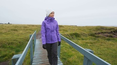 Tourist on travel walking and hiking on Iceland Arnarstapi Snaefellsnes Stock Footage