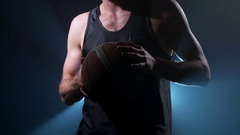 Basketball player holding a basket ball Stock Footage