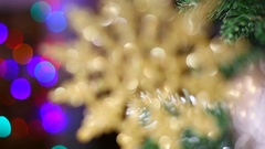 Out of focus round golden snowflake hanging at Christmas tree branches Stock Footage