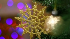 Decorated fir-tree over lights of colourful garland background. Stock Footage