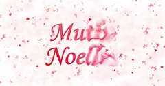 """Merry Christmas text in Turkish """"Mutlu Noeller"""" formed from dust and turns to Stock Footage"""