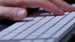 Macro close up of male hands typing on keyboard with white buttons Stock Footage
