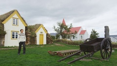 Iceland Tourist by Old Farmhouse Laufas Glaumbaer farm Museum turf roof house Stock Footage