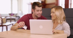 Millennials online shopping together on laptop at home Stock Footage