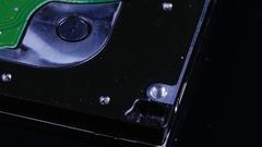 Macro close up of computer hard drive roating around Stock Footage