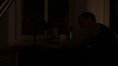 Man turns on and off the table lamp Stock Footage