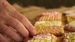 Woman packs gingerbread Stock Footage
