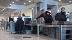 Passengers pass security checks at Domodedovo airport Stock Footage