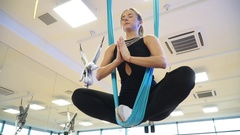 Slow motion, girl in the lotus position in a hammock to fly yoga, slidecam Stock Footage